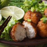 fish balls with lime and salad on a plate macro. horizontal