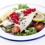 fresh fried plaice with fresh salad and tomatoes